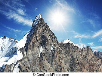 Sun and snow in mountain - Mountain peak on sunny background