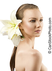 beauty portait of pretty young girl with lilies, she is...