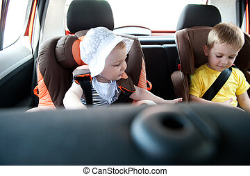 Children traveling in car - Little brother and his baby...