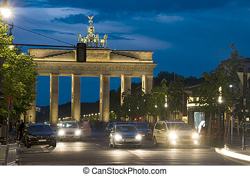 night scene Brandenburg Gate lit with car pedestrian traffic...