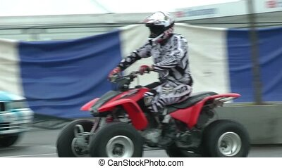 ATV stunt show, back wheels drive - ATV at stunt show, back...