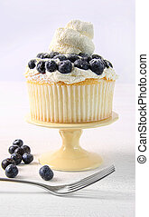 Summer dessert with blueberries and whip cream