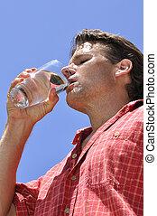 Thirsty man - Inferior shot of hot sweaty thirsty man...