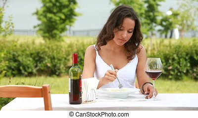 Enjoying meal - Beautiful young woman enjoying her meal and...