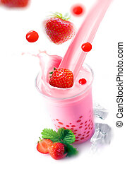 Pouring a glass of strawberry boba tea - Pouring a glass of...