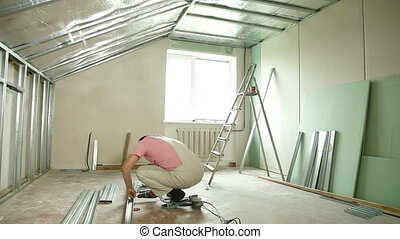 Home improvement - Man installing plasterboard walls in the...