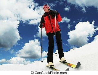 Skier - Girl on skies resort