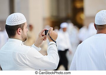 Muslim taking photo at Madina haram - Islamic Holy Place