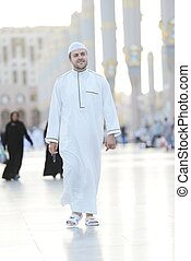 Muslim walking - Islamic Holy Place