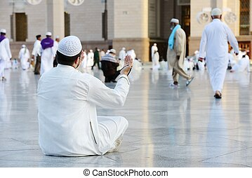 Muslim prayer at holy mosque