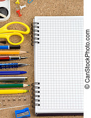school accessories and checked notebook on wood texture