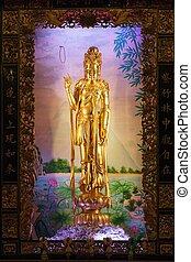 Guan yin statue - golden statue of Guan Yin goddess in...