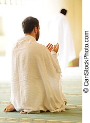 Muslim pilgrims at Miqat - Muslim wearing ihram clothes and...