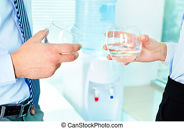Holding glasses - Photo of business partners hands holding...
