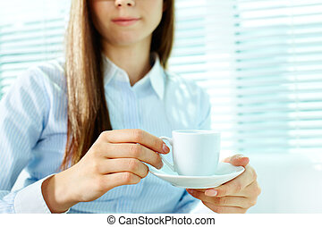 Female with cup - Photo of porcelain coffee cup and saucer...