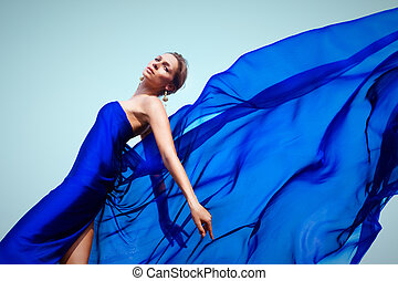 Woman in blue - Photo of graceful female folded in dark blue...