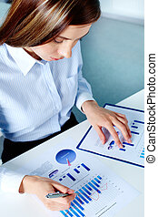 Marketing analysis - Vertical image of businesswoman working...