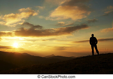 Male silhouette on sunrise - Male on the sunrise in mountain