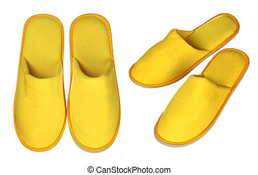 Pair of yellow house slippers isolated on white