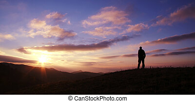 Hello,new day - Male silhouette on sunrise background