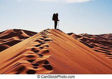 Man on dune - Man go up in sand desert