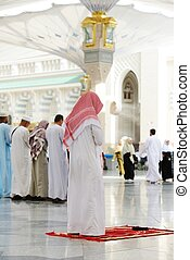 Muslims praying together at Holy mosque - Islamic Prayer