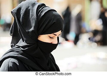 Muslim woman with veil - Arabic Muslim female with scarf and...