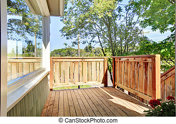 House and fenced front yard with trees. - House and fenced...