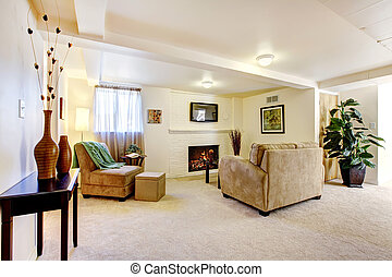 Bright basement living room with fireplace and sofa.