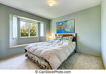 Green simple bedroom with small bed.