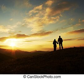 Young family silhouette for sunset