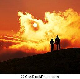 People on sunset - Couple silhouette on sunset
