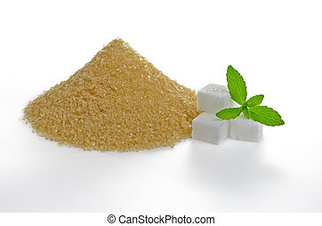 Stevia leaves with sugar cubes and a brown sugar heap