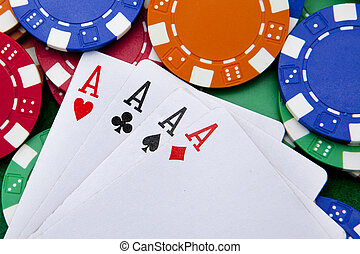 poker, four aces over a background with casino chips