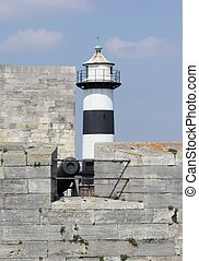 Lighthouse and castle of portsmouth