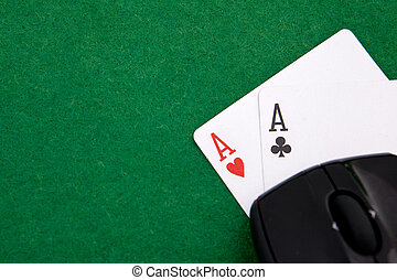 Online Texas holdem pocket aces on casino table with copy space
