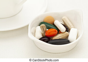 vitamin and supplement pills - bowl of vitamin, supplement...