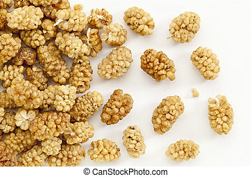 sun-dried white mulberry berries - background of sun-dried...