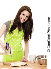happy baking woman pouring baking flour on a table on white background