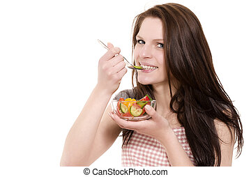 young happy woman eating paprika salad on white background