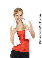 young sporty fitness woman with a towel on white background