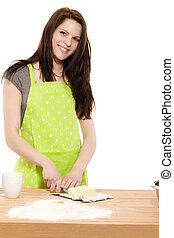 young happy woman cutting butter for baking on white...