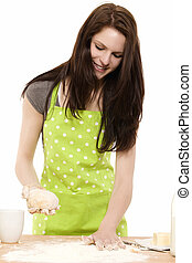 young woman preparing dough for baking on white background