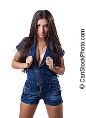 Sexy brunette young woman in denim overalls