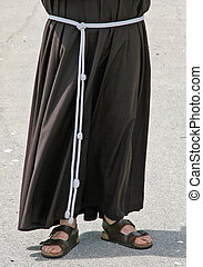 Barefoot with sandals and the habit of a Friar - Barefoot...