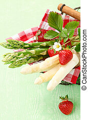 Serving of fresh green and white asparagus