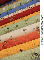 Rolls of Provencal textile on a market stall - Traditional...