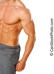 A young man's chest and abs on white background