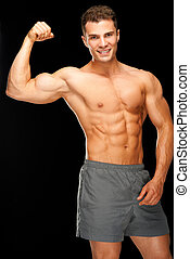 Portrait of confident muscular man flexing his biceps on...