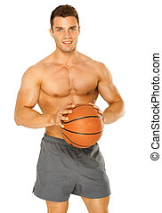 Portrait of a young male basketball player gripping the ball